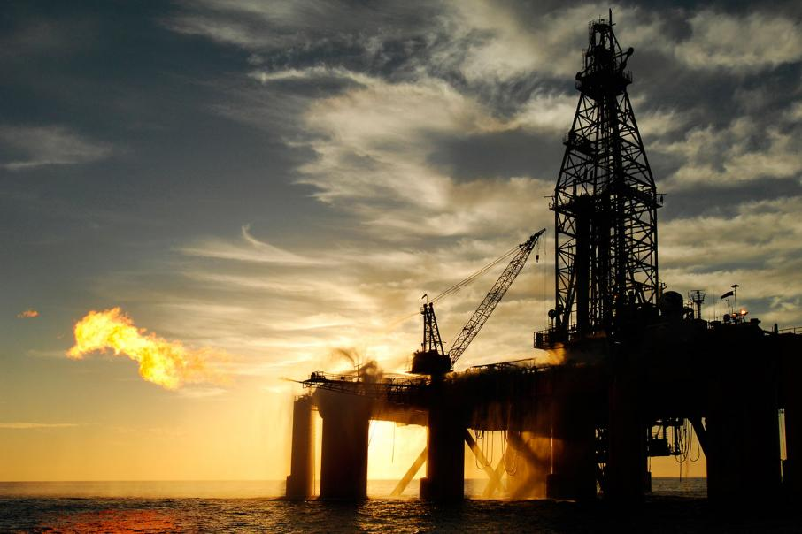 Oil up as OPEC output cuts drain stocks